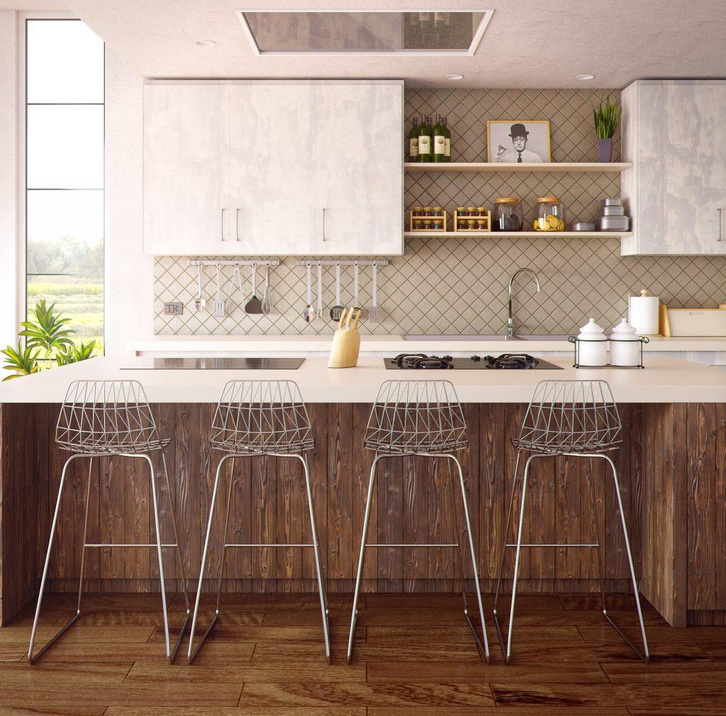 cuisine avec ilot central et chaises hautes